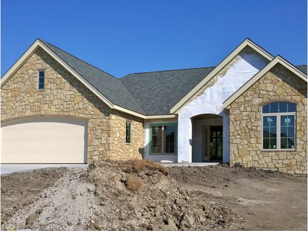 Stone façade complete on this custom home in the Reserve at McFarland Farm