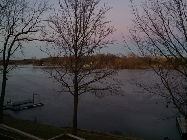 Lake Jivaro at sunset. Convenient to both Lawrence and Topeka, boater friendly lake living