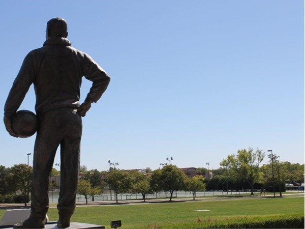Sculpture of James Naismith overlooks the KU campus