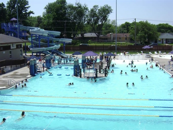 Memorial Pool is a popular summer spot for local residents with water slides & children's play pool
