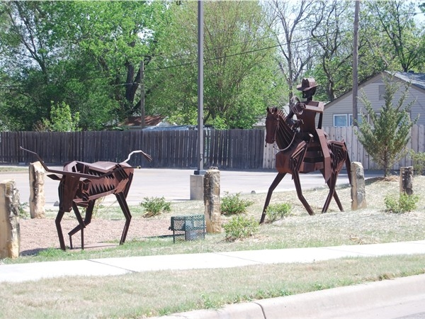 The famous Rancher and Bull statues in front of Subway