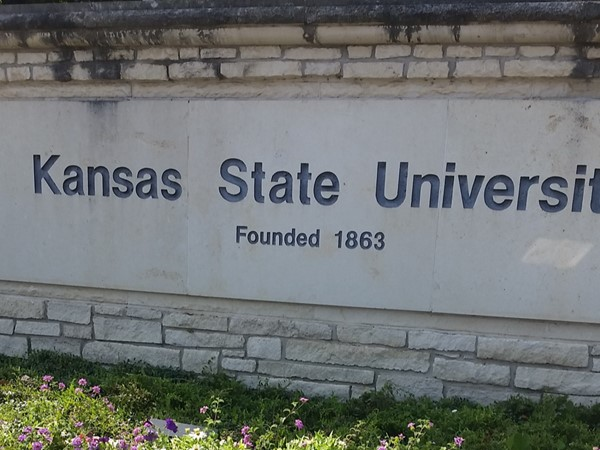 The entrance to Kansas State University brings you into the purple state environment with flowers