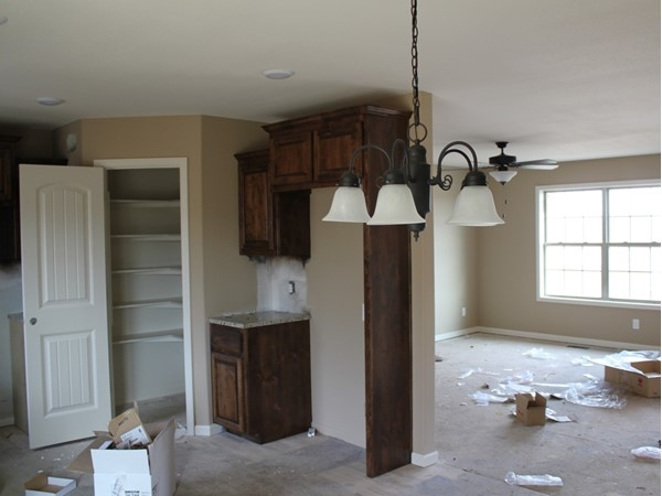 Madisyn update!  Kitchen has granite counter tops, stained cabinets and a nice pantry closet