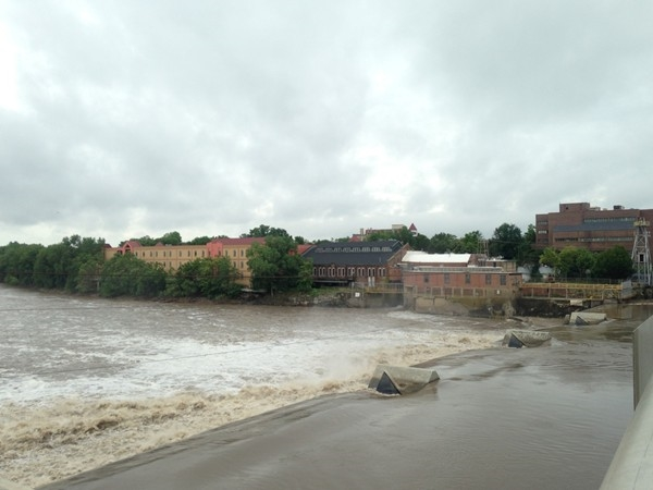 Rainy weather leads to the Kansas River rushing over the Bowersock Dam in Downtown Lawrence