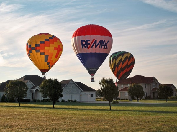Soft landing for the RE/MAX ballloon near a private airstrip